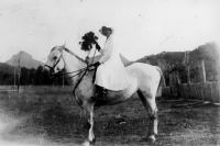 Vera Johnson seated on her white horse Mt. Barney ca. 1916.